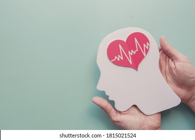 Hands holding paper brain and heart, brain stroke, world heart day, world mental health day, Alzheimer and wellness concept