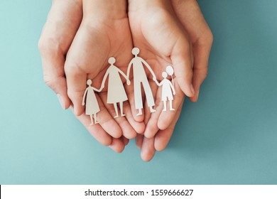 hands holding paper family cutout, family home, adoption, foster care, homeless charity , family mental health, homeschooling education, Autism support, domestic violence, social distancing concept