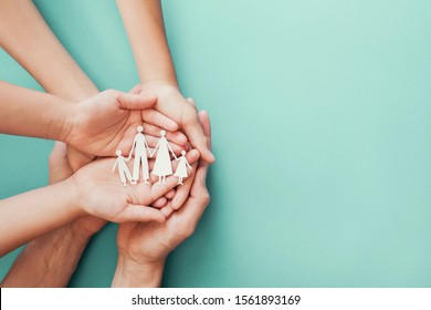 hands holding paper family cutout, family home, adoption, foster care, homeless charity, family mental health, homeschooling education, Autism spectrum support, domestic violence, social distancing