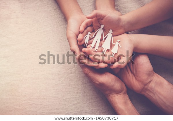 hands holding paper family cutout, family home, foster care, homeless support, social distancing, world mental health day, Autism support,homeschooling education, domestic violence