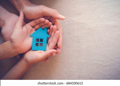 hands holding paper house, family home, homeless shelter and real estate, housing and mortgage crisis, foster home care, family day care, social distancing