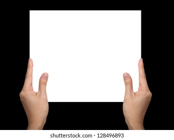 Hands holding paper isolated on black