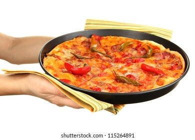 hands holding pepperoni pizza in pan isolated on white