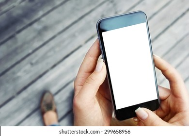 Hands holding phone