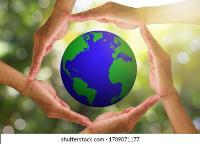 Hands holding planet earth on blurred green bokeh nature with warm sunlight background, environmental concept