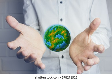 Hands holding and protecting earth