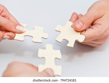 Hands holding puzzle concept