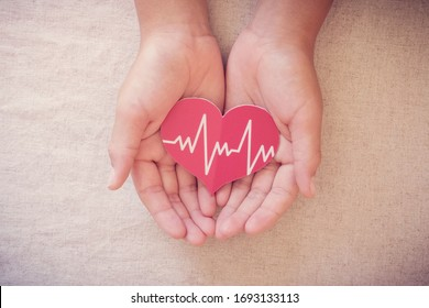 hands holding red heart with cardiogram, health care, life insurance business concept, world heart day, world health day, praying concept