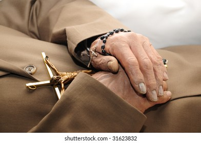 Hands holding a rosary.