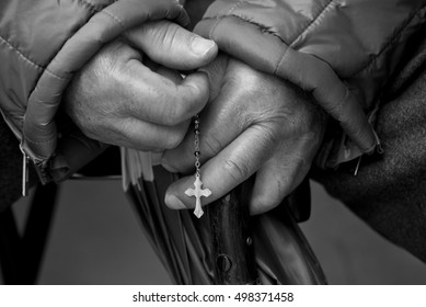 Hands holding the Rosary in Fatima, Portugal
