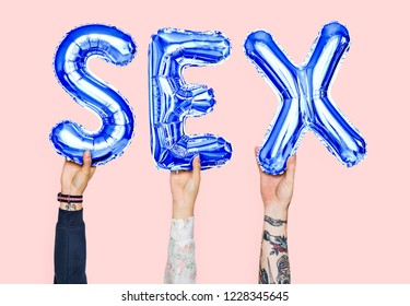 Hands holding sex word in balloon letters