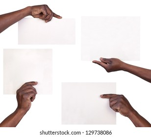 Hands holding sheets of paper isolated on white background