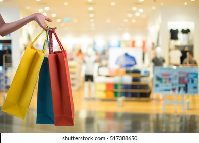 hands holding shoping bags