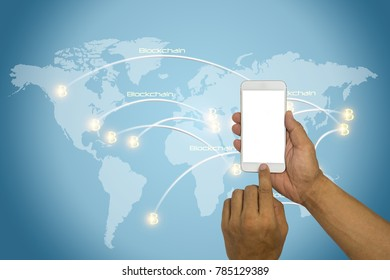 Hands holding smart phone with blank to buy bitcoin and block chain with connexions on a world map. Finance and crypto currency security concept