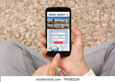 Hands holding smart phone with travel agency concept on screen. All screen content is designed by me. Flat lay