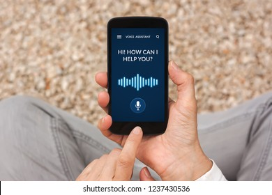 Hands holding smart phone with voice assistant concept on screen. All screen content is designed by me. Flat lay