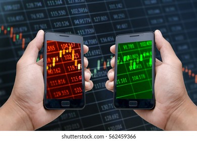 Hands holding smartphones displaying candlestick charts with red and green screens to indicate different stock market situations