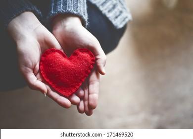 hands holding a soft heart shape