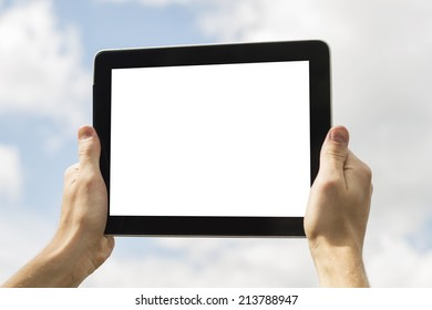 Hands holding tablet