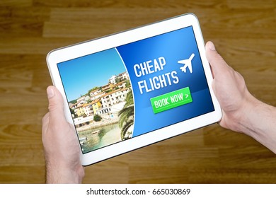Hands holding tablet with cheap flghts for sale add on internet. Affordable and inexpensive vacation offer on screen. Imaginary low cost carrier application on mobile device. Book now.