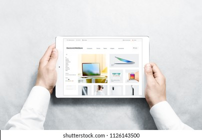 Hands holding tablet with electronic webstore mock up on screen, isolated. Phones web page interface mockup. Internet website online template on the device display.
