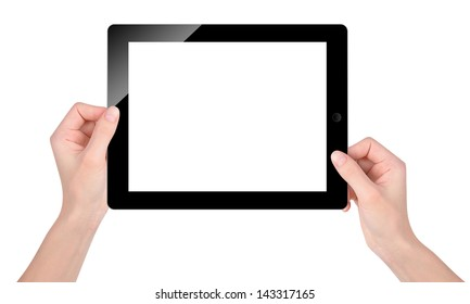 Hands are holding a technology tablet with a blank, white screen on an isolated background.