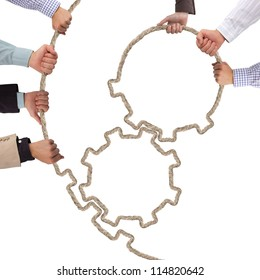 Hands holding tooth wheels, teamwork concept