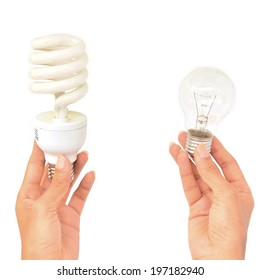 Hands holding traditional and energy efficent lightbulbs isolated on white background