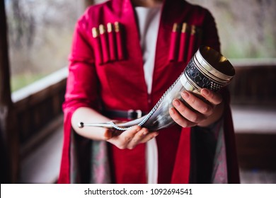 Hands holding a traditional georgian drinking horn