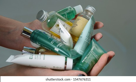 Hands holding travel size toiletries. California will ban hotels from supplying such bottles by 2023 in effort to reduce plastic waste. Illustrative editorial taken Vista, CA / USA - October 30, 2019.