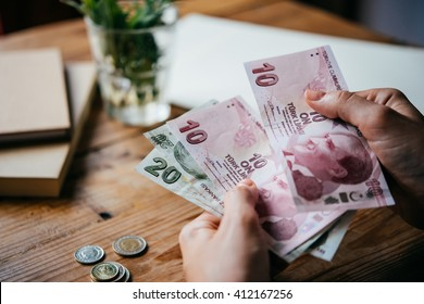 Hands holding turkish lira bills