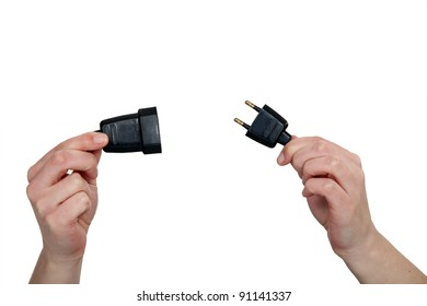 hands holding two prong plug