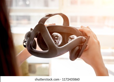 Hands holding virtual reality helmet. Concept for virtual visual in future, Game or video of vr technology