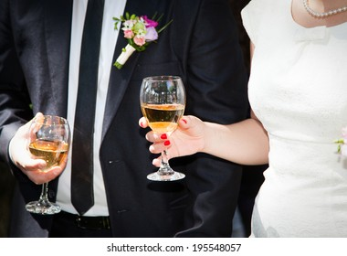 Hands holding wine glasses
