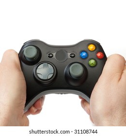 Hands holding a wireless gaming controller, isolated on white.