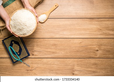 fitrah images stock photos vectors shutterstock https www shutterstock com image photo hands holding wooden bowl rice grains 1733334140