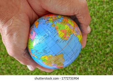 Hands holding a world globe Background