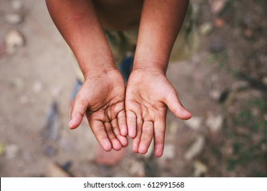 Hands of a homeless child,begging palm, begging hand, Hungey man.