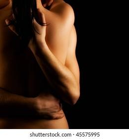Hands hugging a girl in love