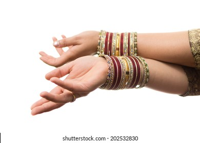 Hands of Indian girl wearing bangles on white background