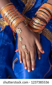 Hands of an Indian woman decorated with costume jewelry in Pushkar, India. Close up
