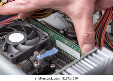 Hands installing ram memory