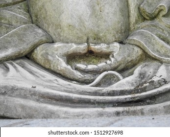 Hands of Japanese Buddhist statue in Dhyana mudra (Samadhi mudra) hand gesture with palms resting in lap and thumbs facing each other used in meditation, Yoga and Buddhism