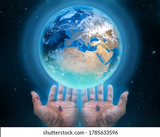 Hands of Jesus holding the earth. Religious theme concept.