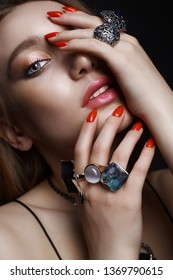 hands with jewelry rings. beautiful girl with make-up and manicure