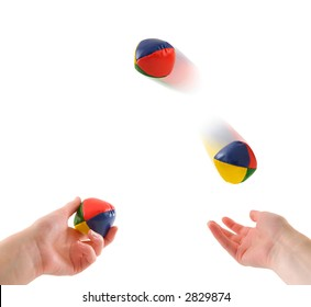 Hands juggling three balls, isolated on white.