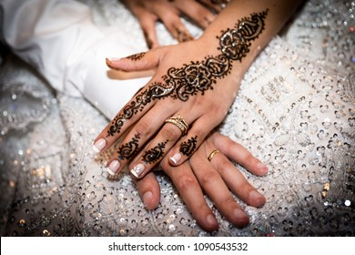 hands of just married couple, with a henna tatoo