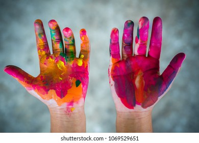 hands kid dirty with watercolor