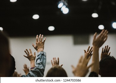 Hands lifted in praise at a church