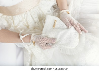 Hands of a little girl in the First Communion Day